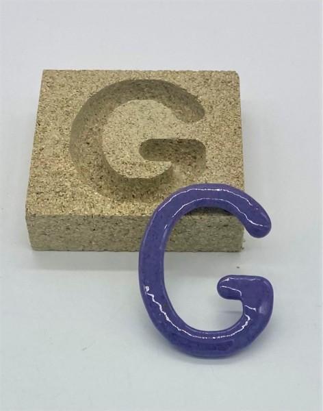 Form aus Vermiculite Buchstabe G
