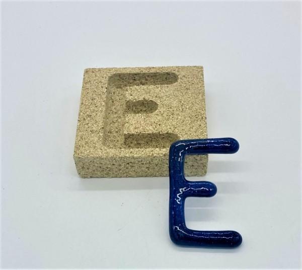 Form aus Vermiculite Buchstabe E